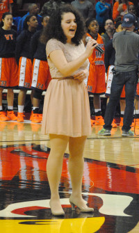 Senior Sarah Rosenberg sings the National Anthem at Red Bird Arena this past Saturday at the girls' 4A basketball championship